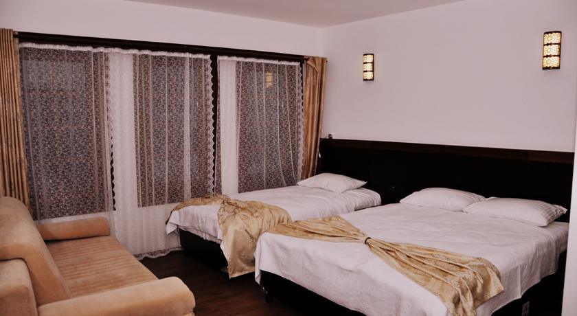 3KİŞİLİK-oda-simre-otel